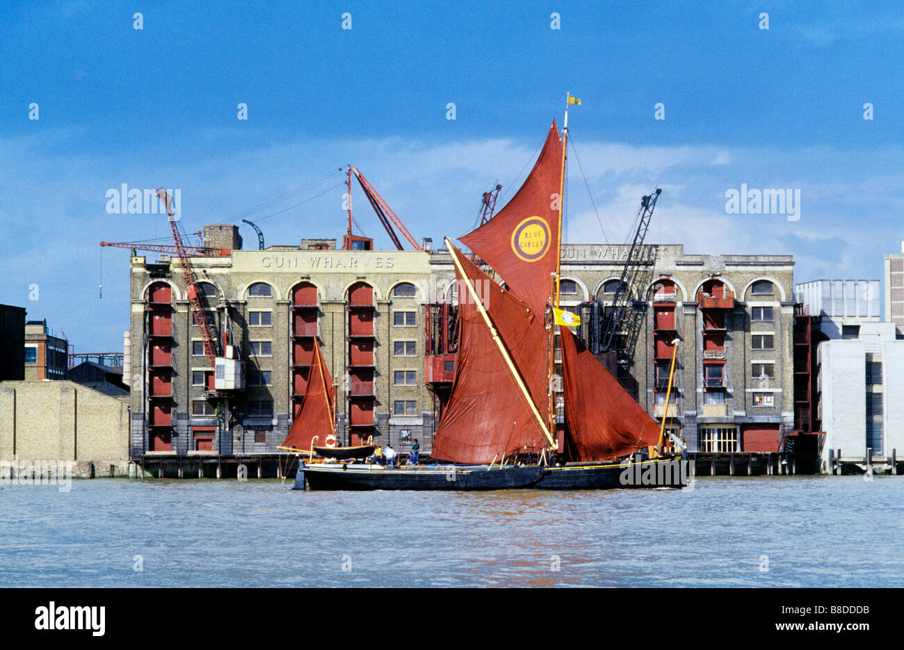 London,RiverThamesBarge,TheRed Ochre sails evoke the past.Now there is a revival as people avoid the stress of modern - Stock Image