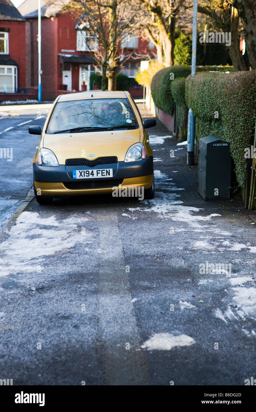 car parked on pavement - Stock Image