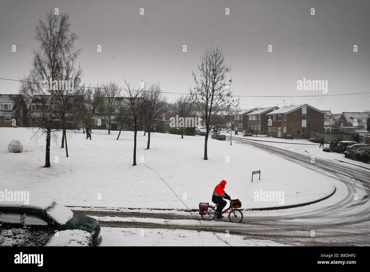 Postman in the snow - Stock Image