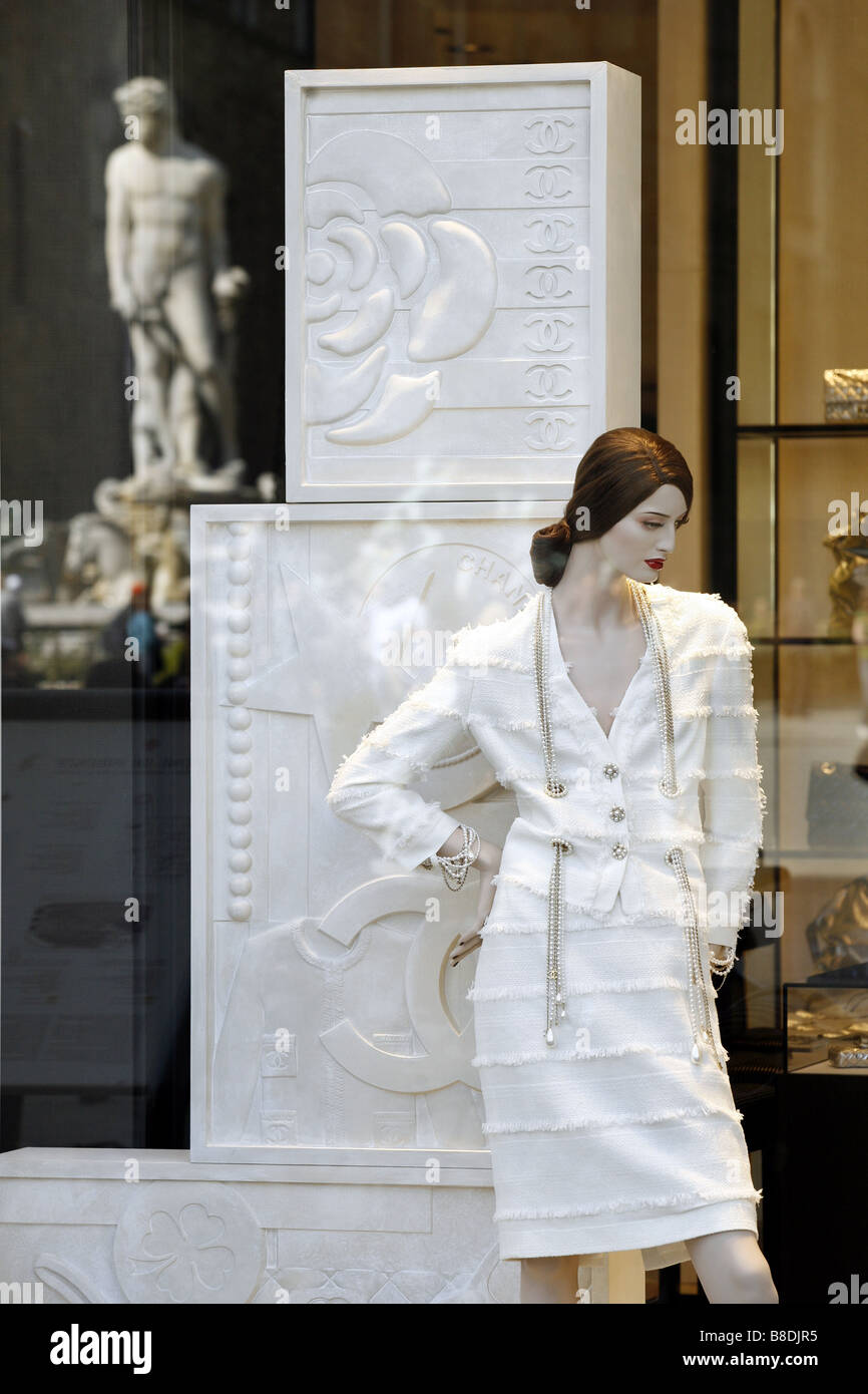 Chanel Shop Window, With Reflection Of The Neptune Fountain, Piazza Della Signoria, Florence, Tuscany, Italy - Stock Image