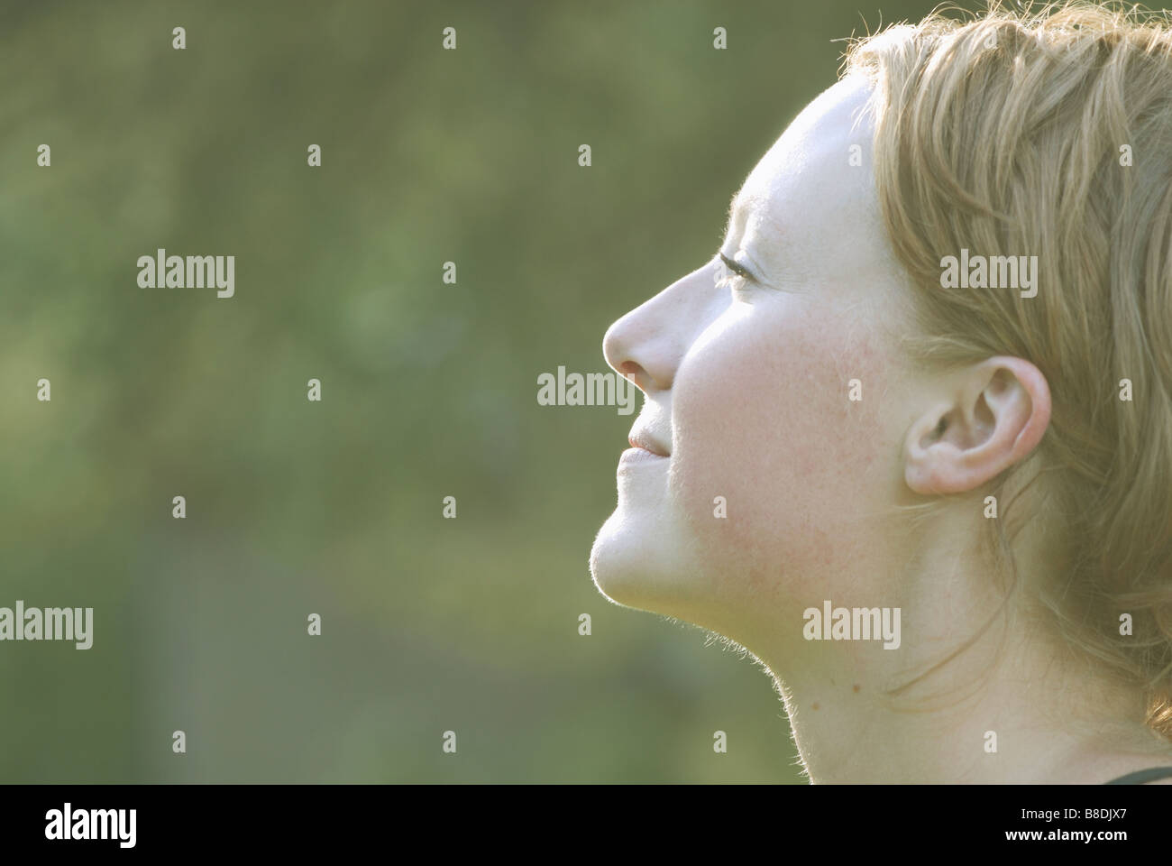Profile of woman's face tilted upward, Grayling Lake, Riding Mountain National Park, Manitoba, Canada - Stock Image