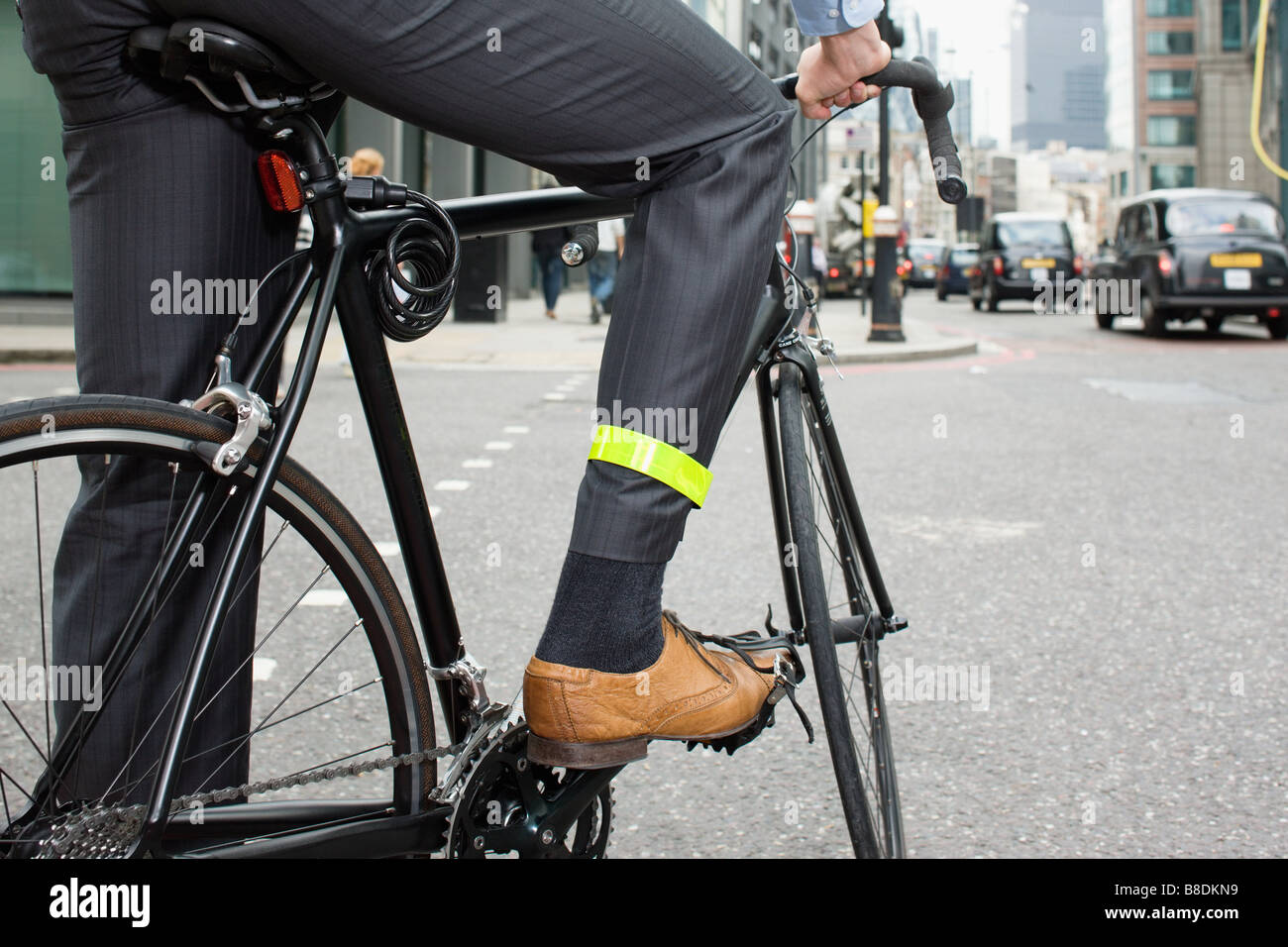 Man riding bicycle - Stock Image
