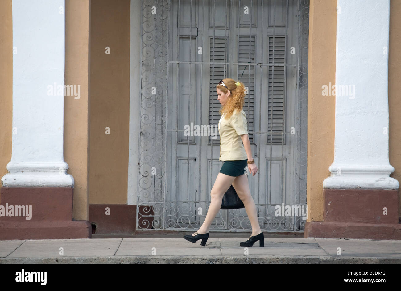 Young blonde woman wearing a miniskirt in Cienfuegos, Cuba - Stock Image