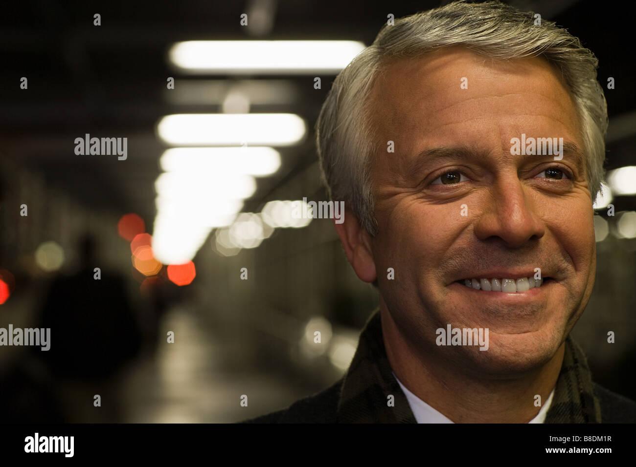 Headshot of a smiling mature man - Stock Image