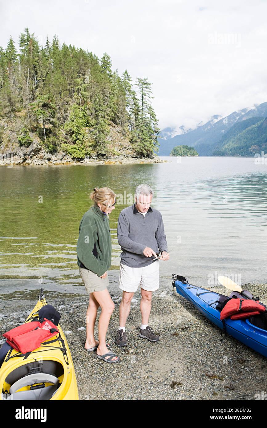 Couple with kayaks - Stock Image
