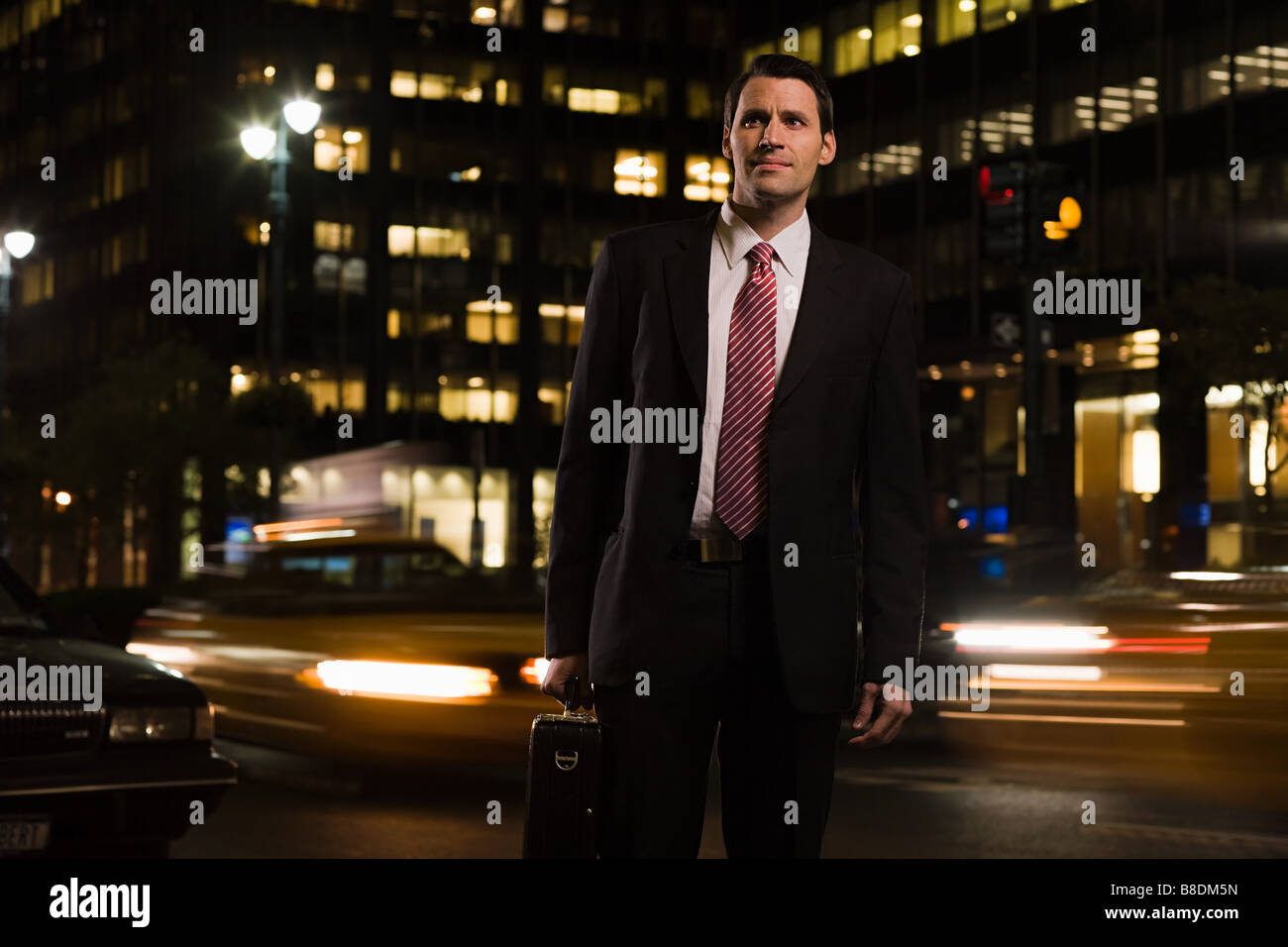 Businessman standing in the road - Stock Image