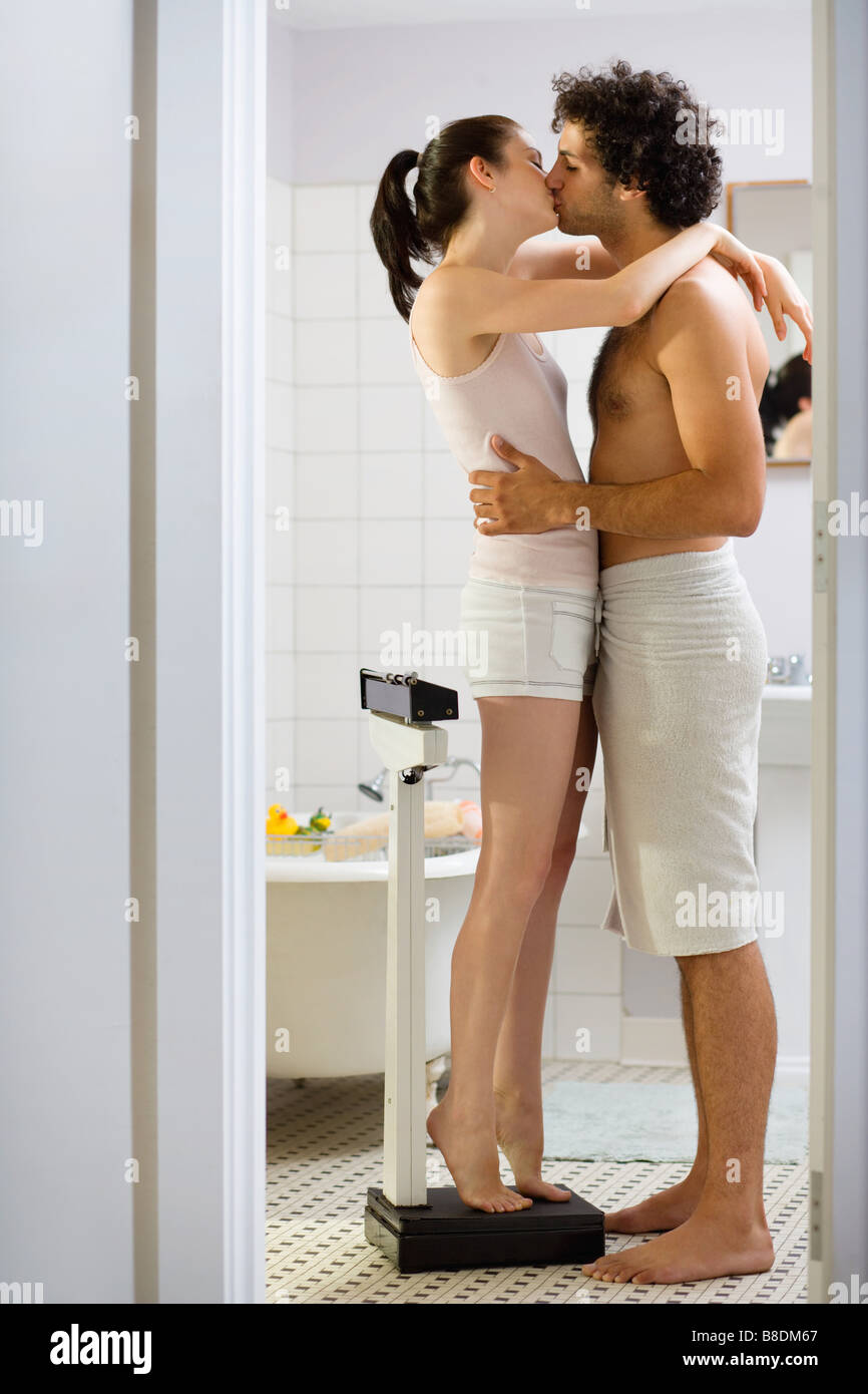 Couple Kissing In The Bathroom