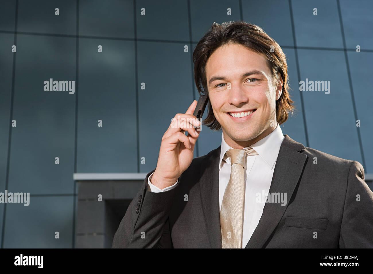 Businessman on cellphone - Stock Image