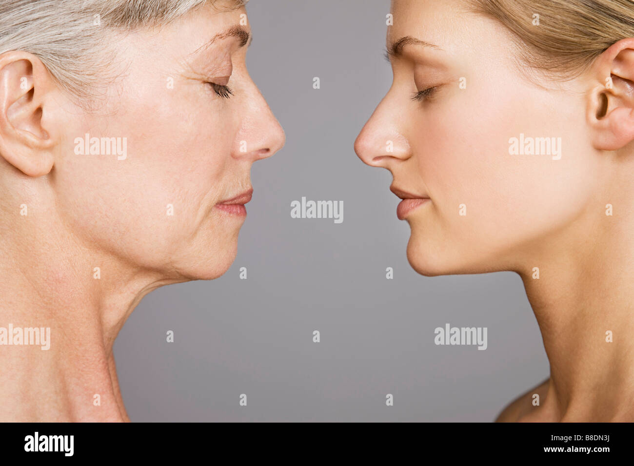 Young and senior women face to face - Stock Image