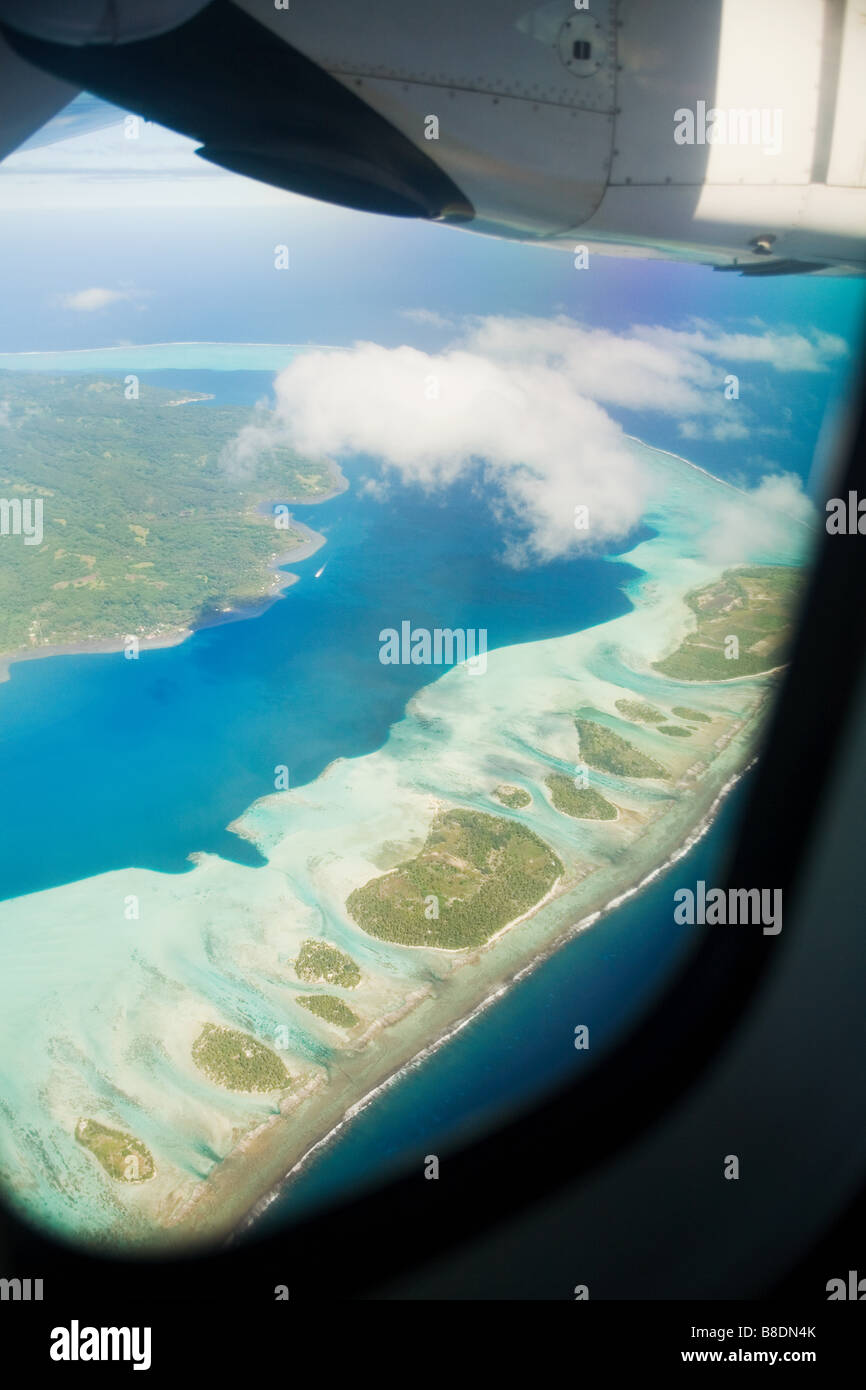 Airplane over society islands - Stock Image