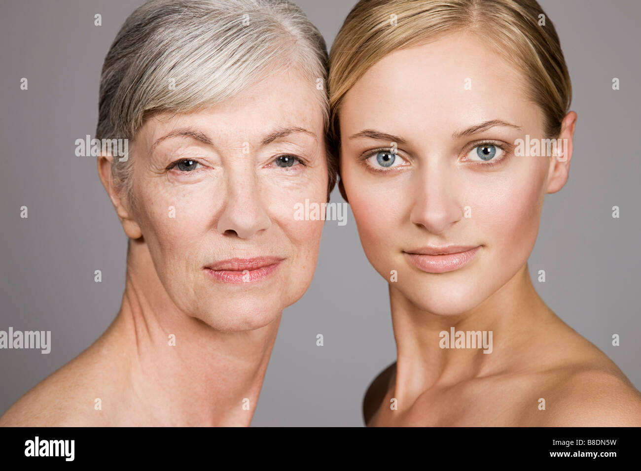 Faces of young and senior women - Stock Image