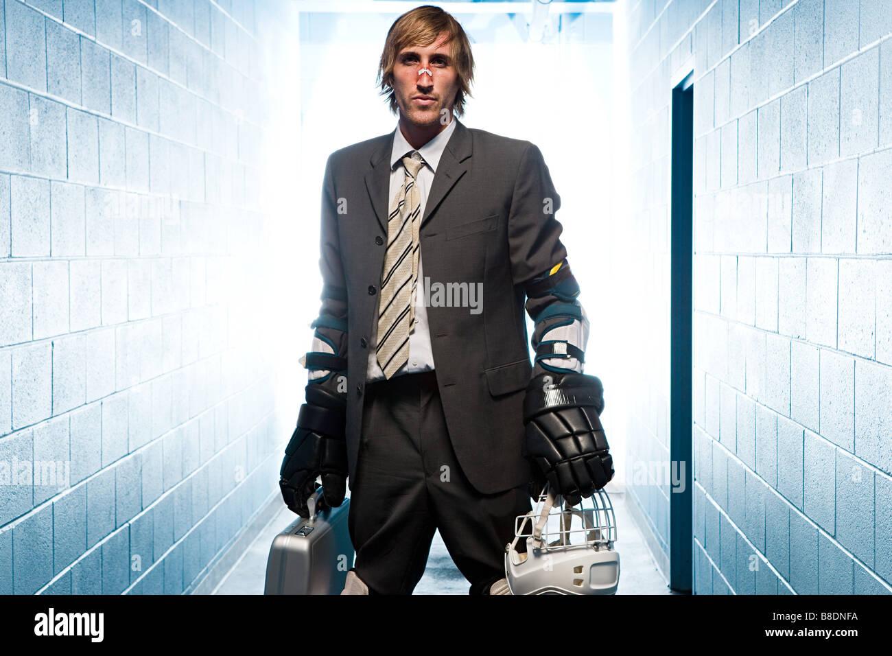 Businessman with an ice hockey uniform - Stock Image
