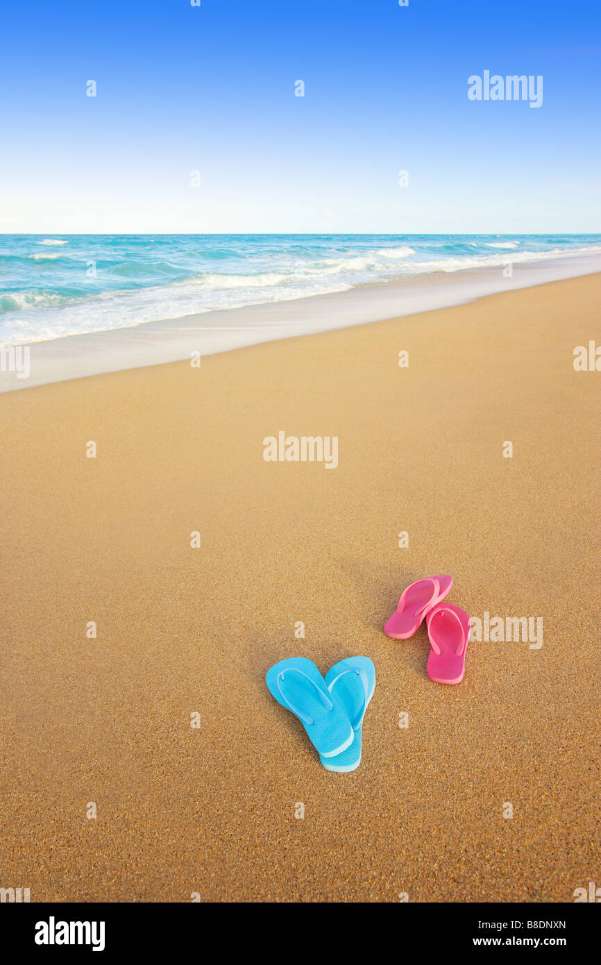 Flip flops discarded on the beach - Stock Image
