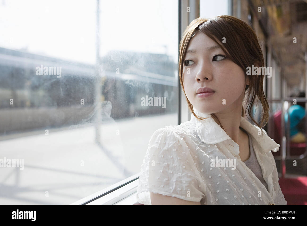 Young woman on train - Stock Image