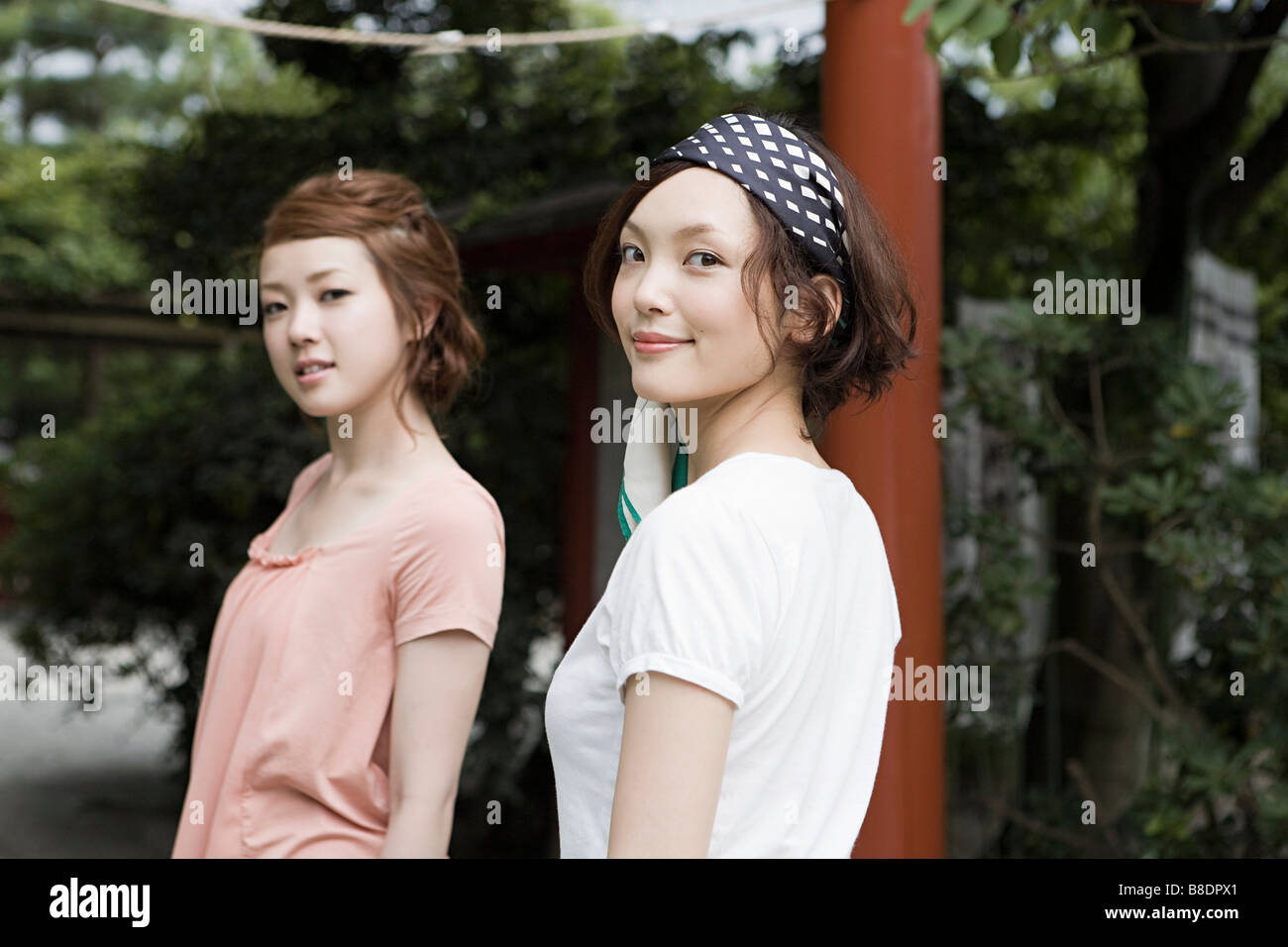 Young women at shrine - Stock Image