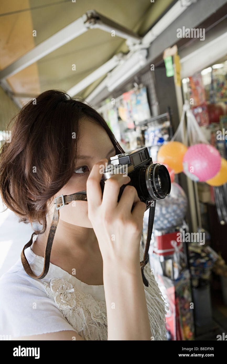 Young woman with camera - Stock Image