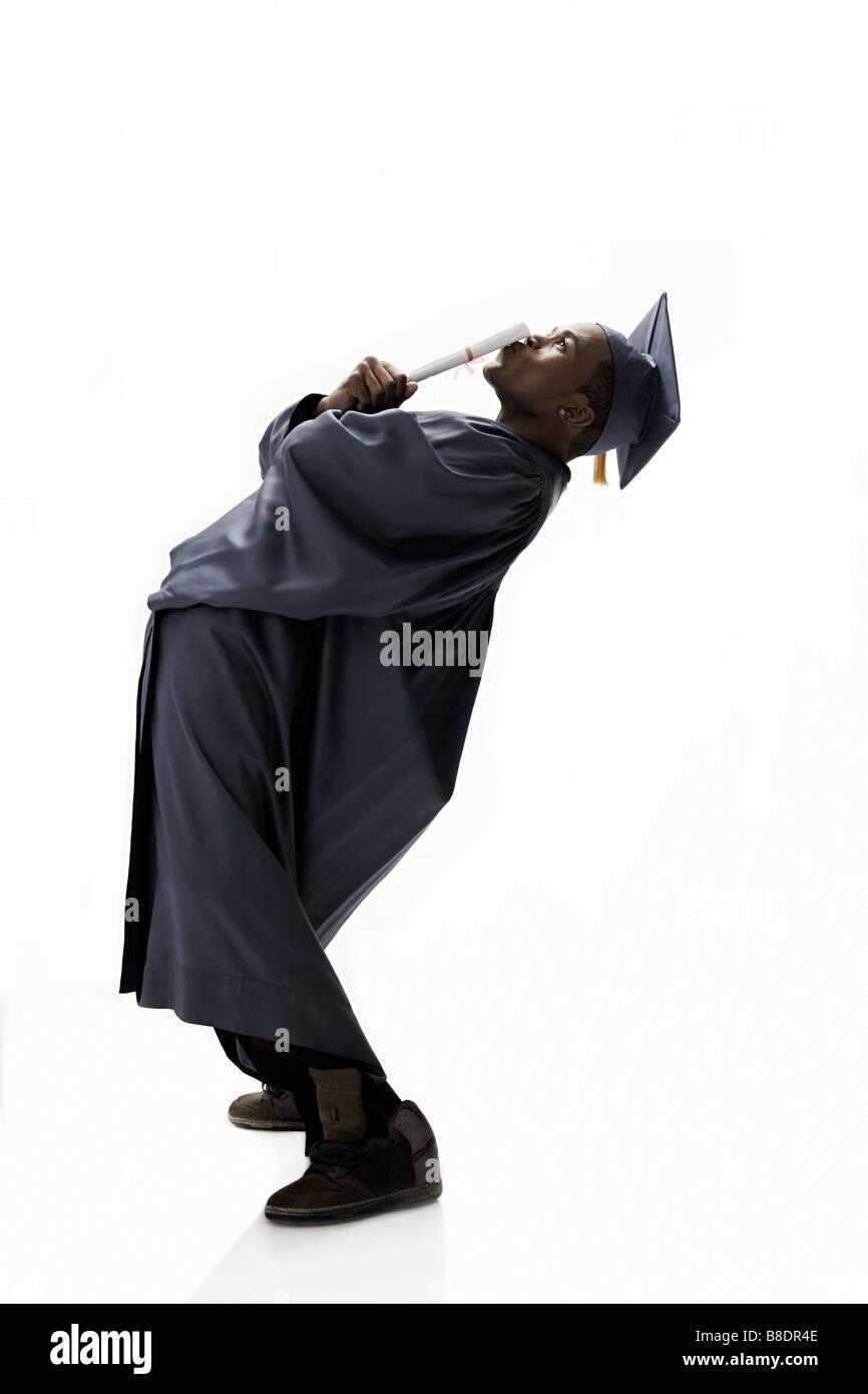 Graduate kissing scroll - Stock Image