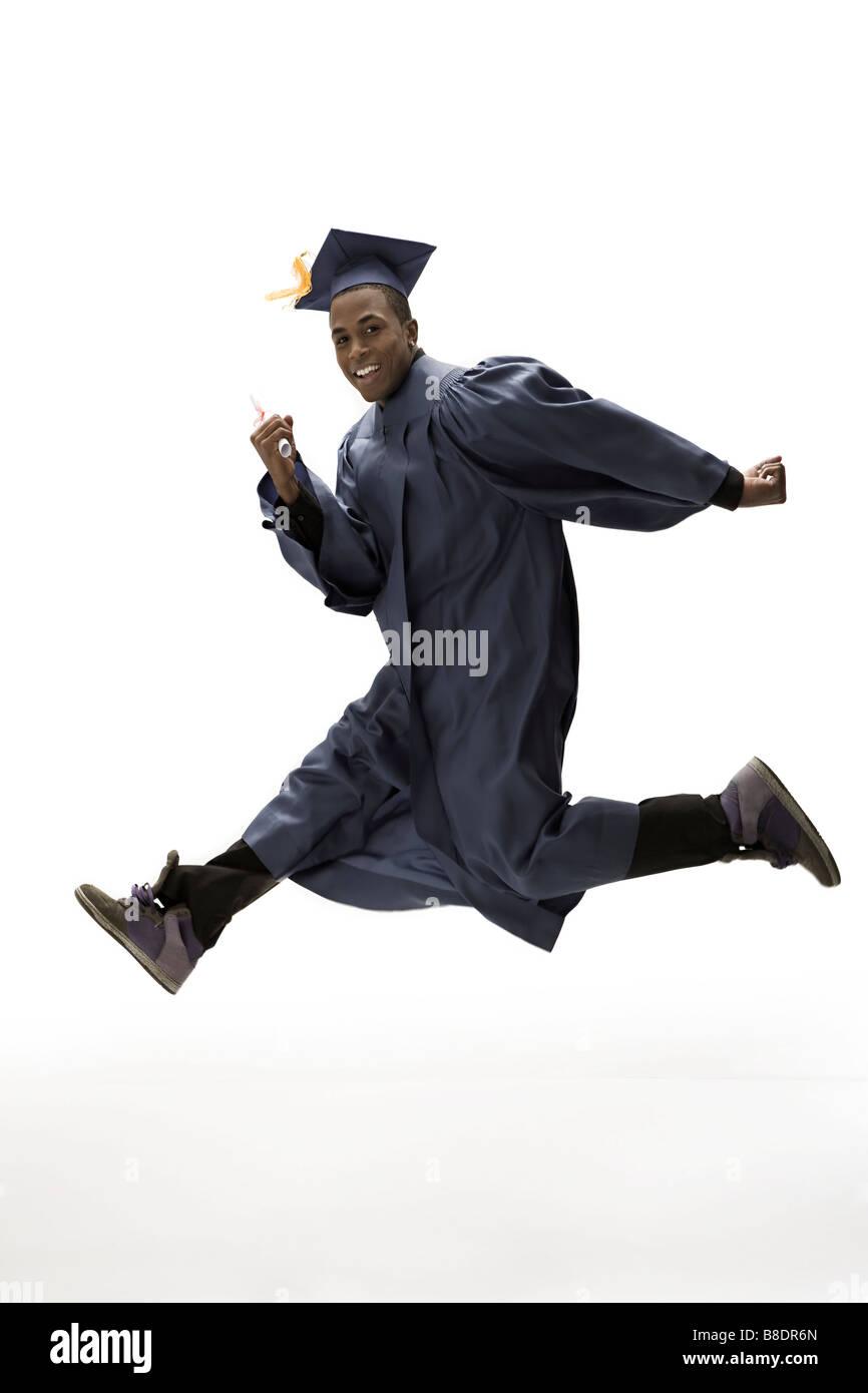 Graduate jumping - Stock Image