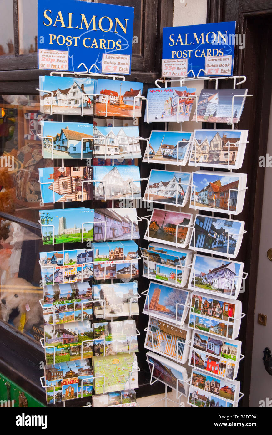 Postcards for sale on a postcard stand outside a shop store in Lavenham,Suffolk,Uk - Stock Image