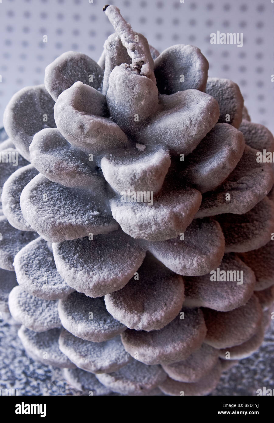 Closeup of a Christams candle in the shape of a pine cone - Stock Image