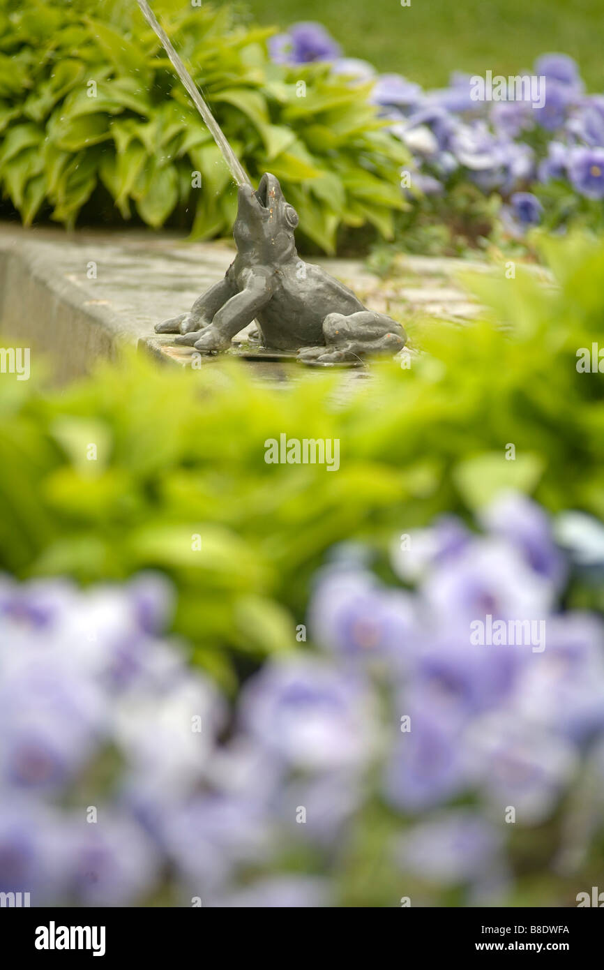 Frog sprinkling water into a fountain in the city park, Visby the capital of the Gotland island Sweden - Stock Image