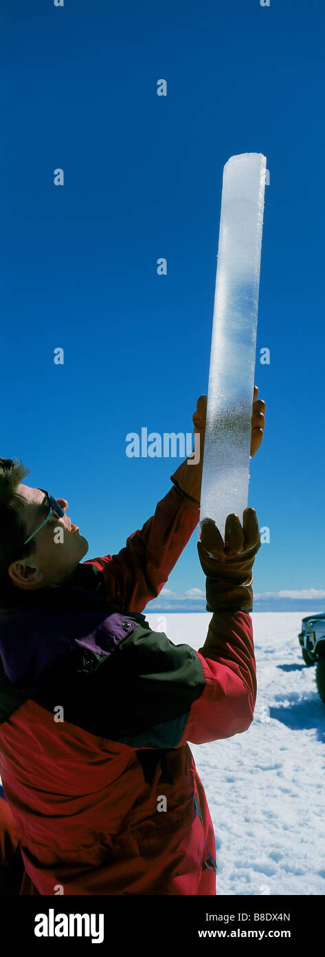 Scientist holding up ice core sample from Langjokull Ice Cap, Iceland - Stock Image