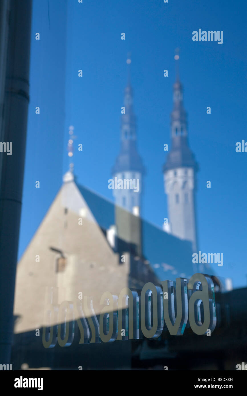 Tallin the capital of Estonia. Church reflection view on the Old Town square - Stock Image