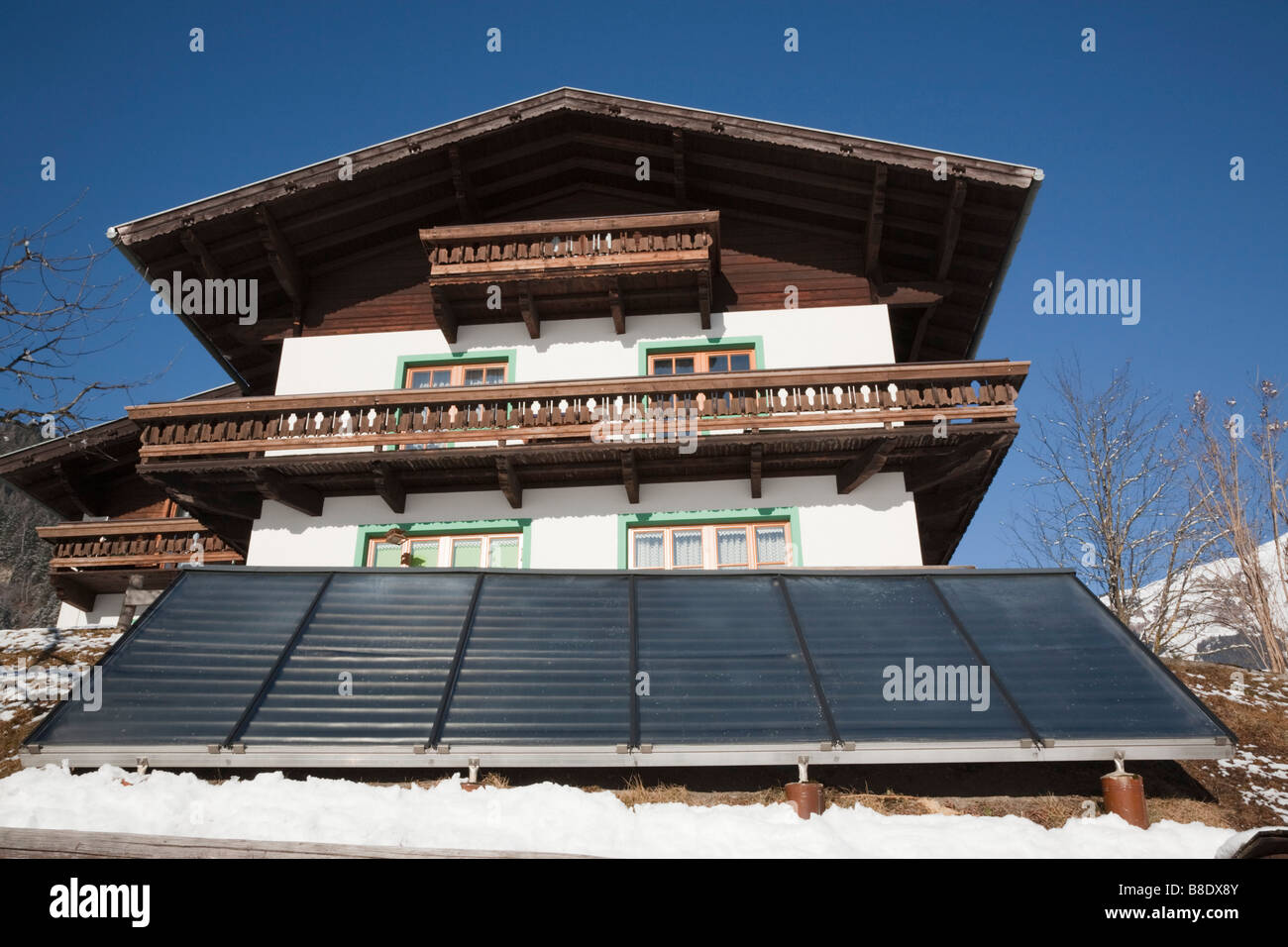Austria Europe. Large solar panels outside an Austrian chalet house for domestic home water heating - Stock Image