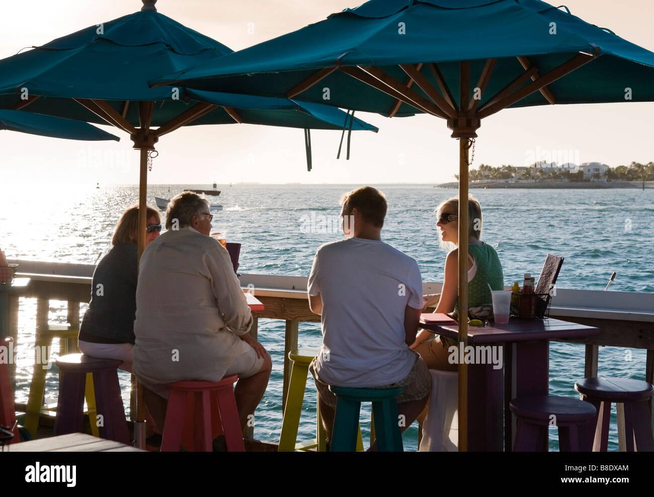 Sunset Pier bar and restaurant just before sunset, Ocean Key Resort, Old Town, Key West, Florida Keys, USA - Stock Image