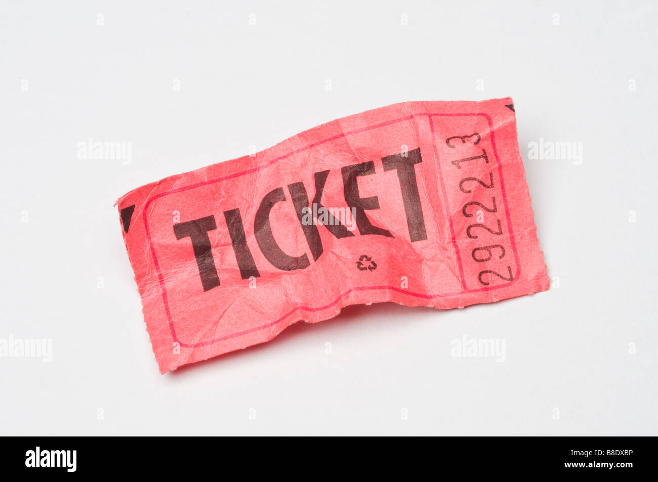 a crumpled red raffle ticket on white - Stock Image