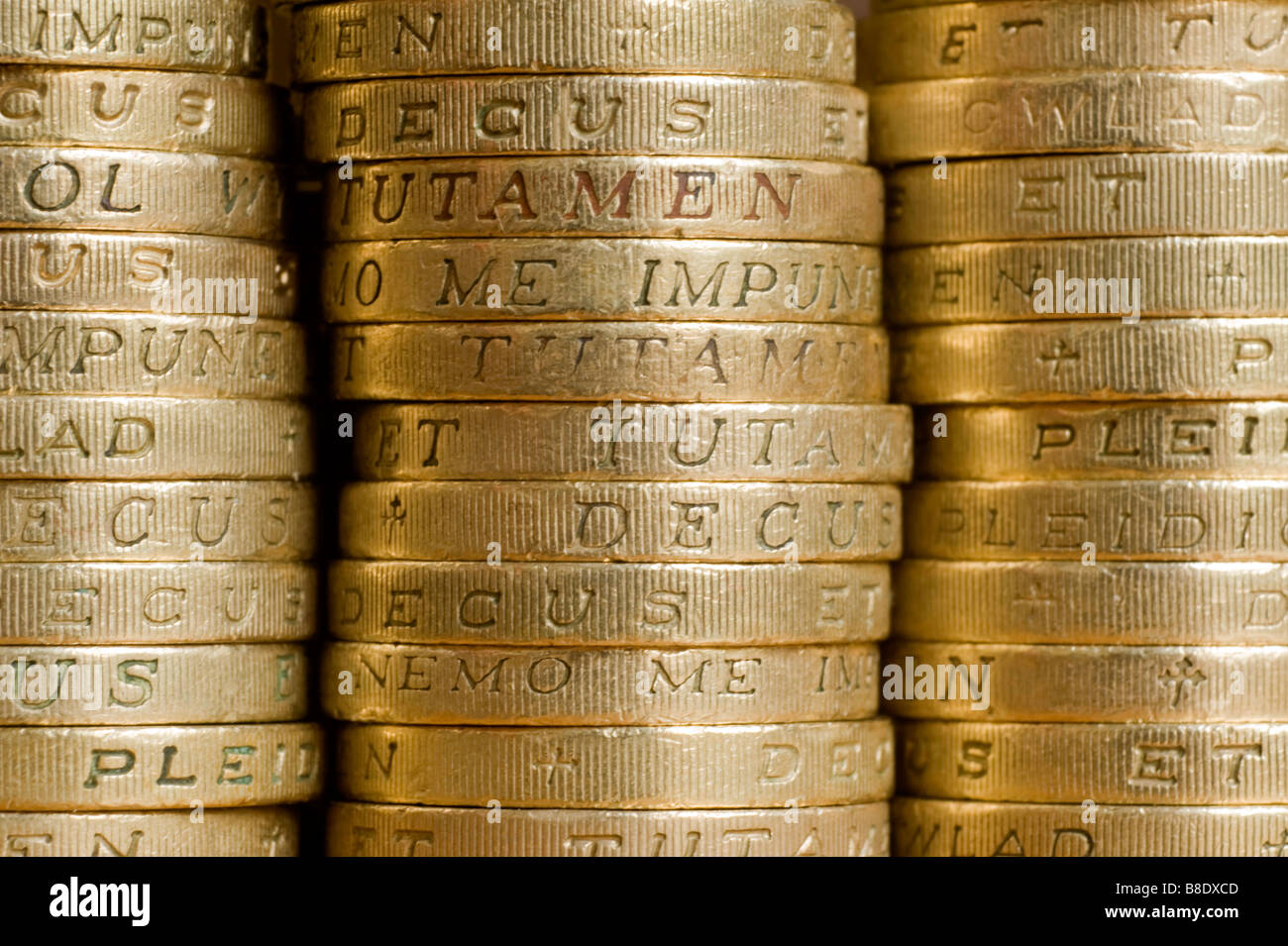 One pound coins in piles Picture by Andrew Hasson February 17th 2009 - Stock Image
