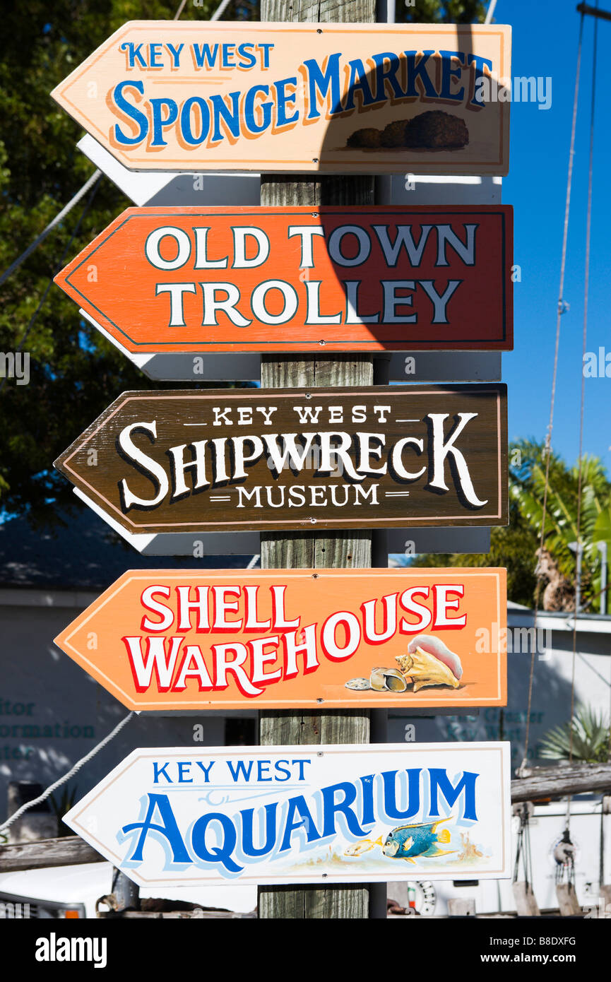 Signs for attractions at Mallory Square, Old Town, Key West, Florida Keys, USA - Stock Image