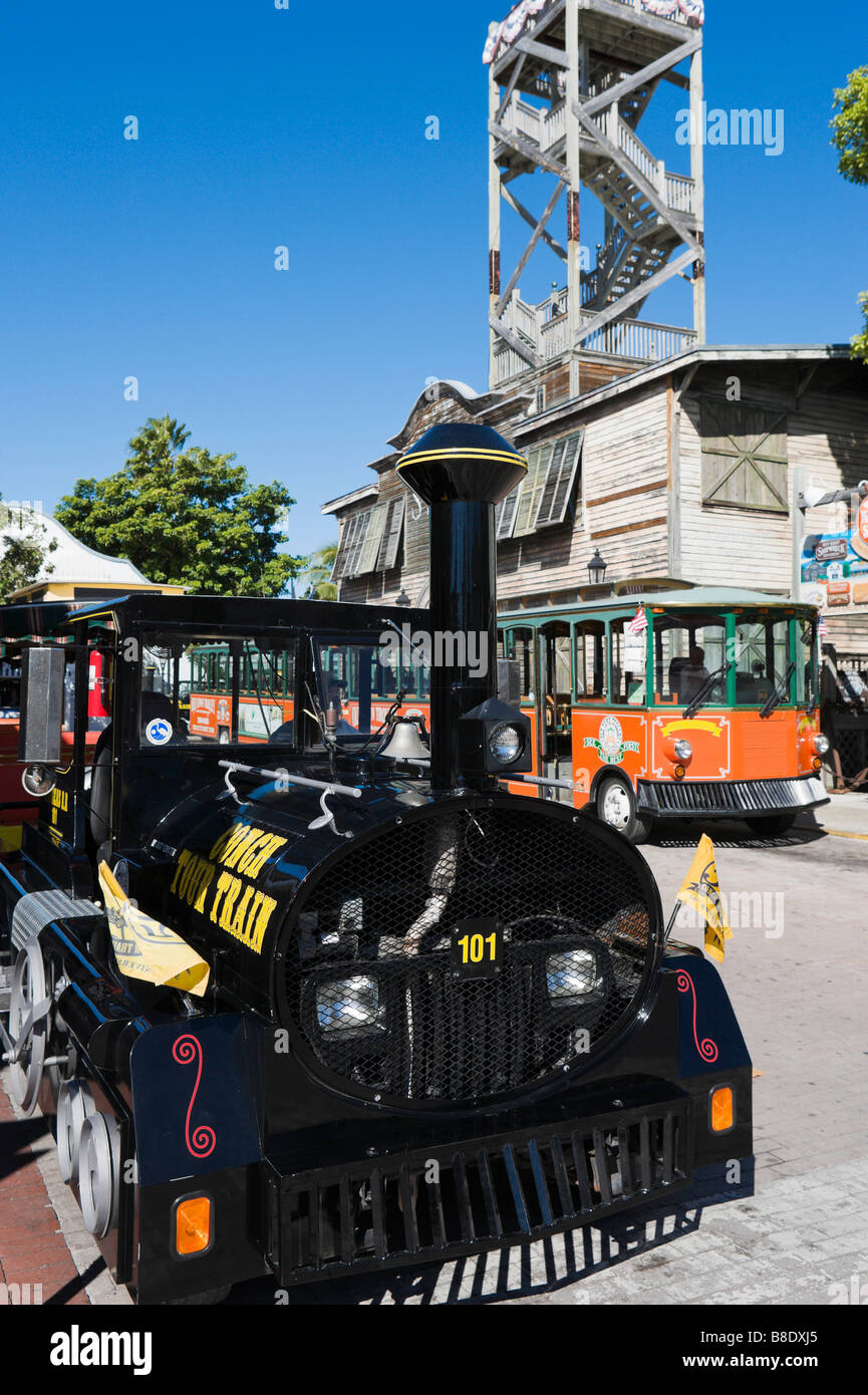 Conch Tour Train and Old Town Trolley at Mallory Square, Historic District, Key West, Florida Keys, USA - Stock Image