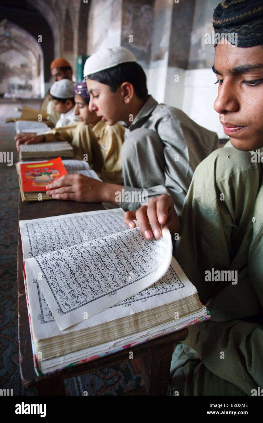 Boys study and memorize Qur'an in one of the old mosques of Lahore, Pakistan - Stock Image
