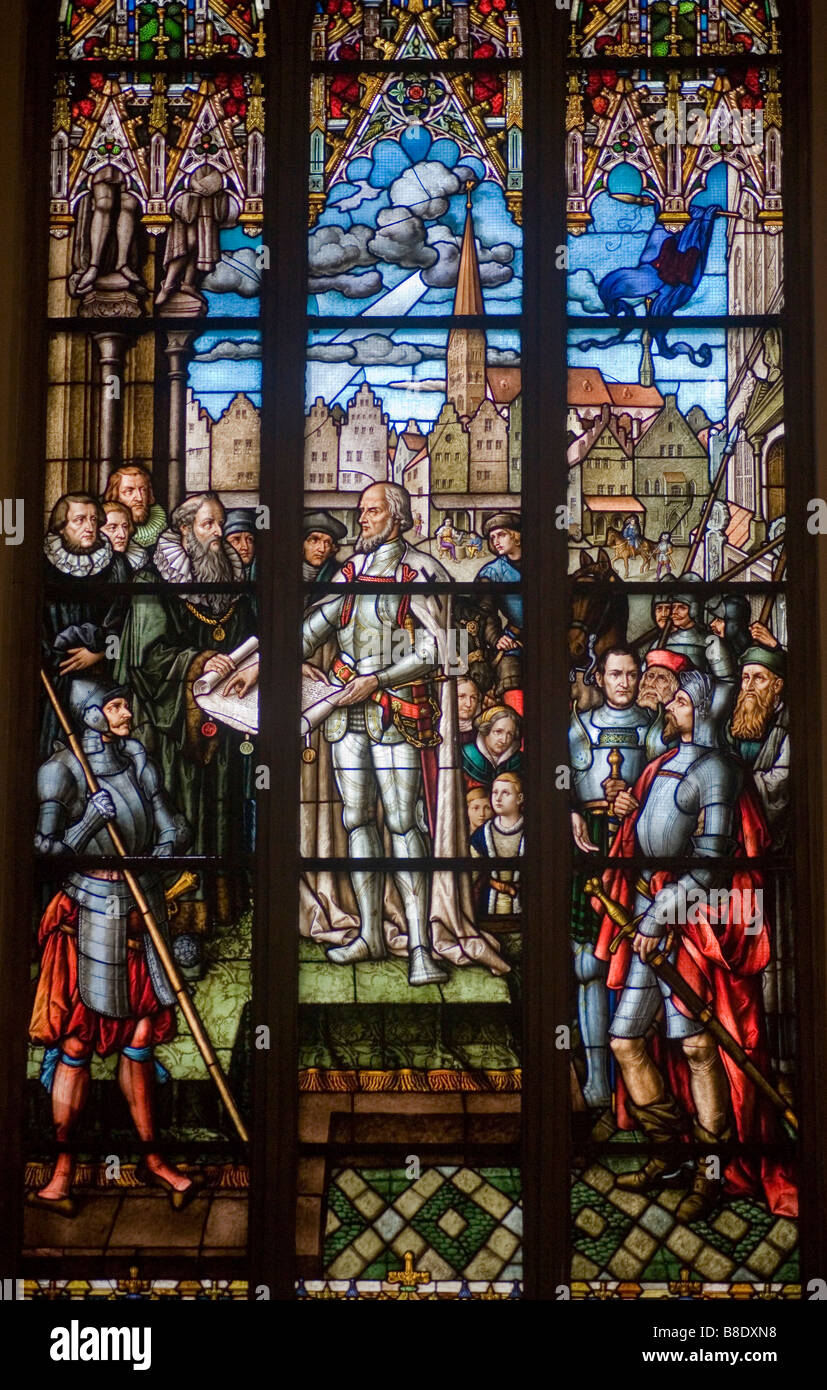 Stainglass window in St Peters Church in Riga, the capital of Latvia showing the signing of the Hanzeatic League - Stock Image