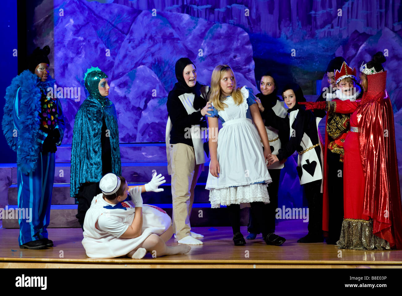 Middle school students on stage in a theatrical production. - Stock Image