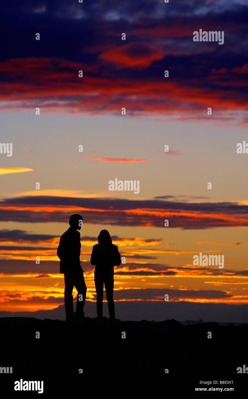 49e67cd2d1008 Couple watching midnight sunset, Reykjavik Iceland Stock Photo ...