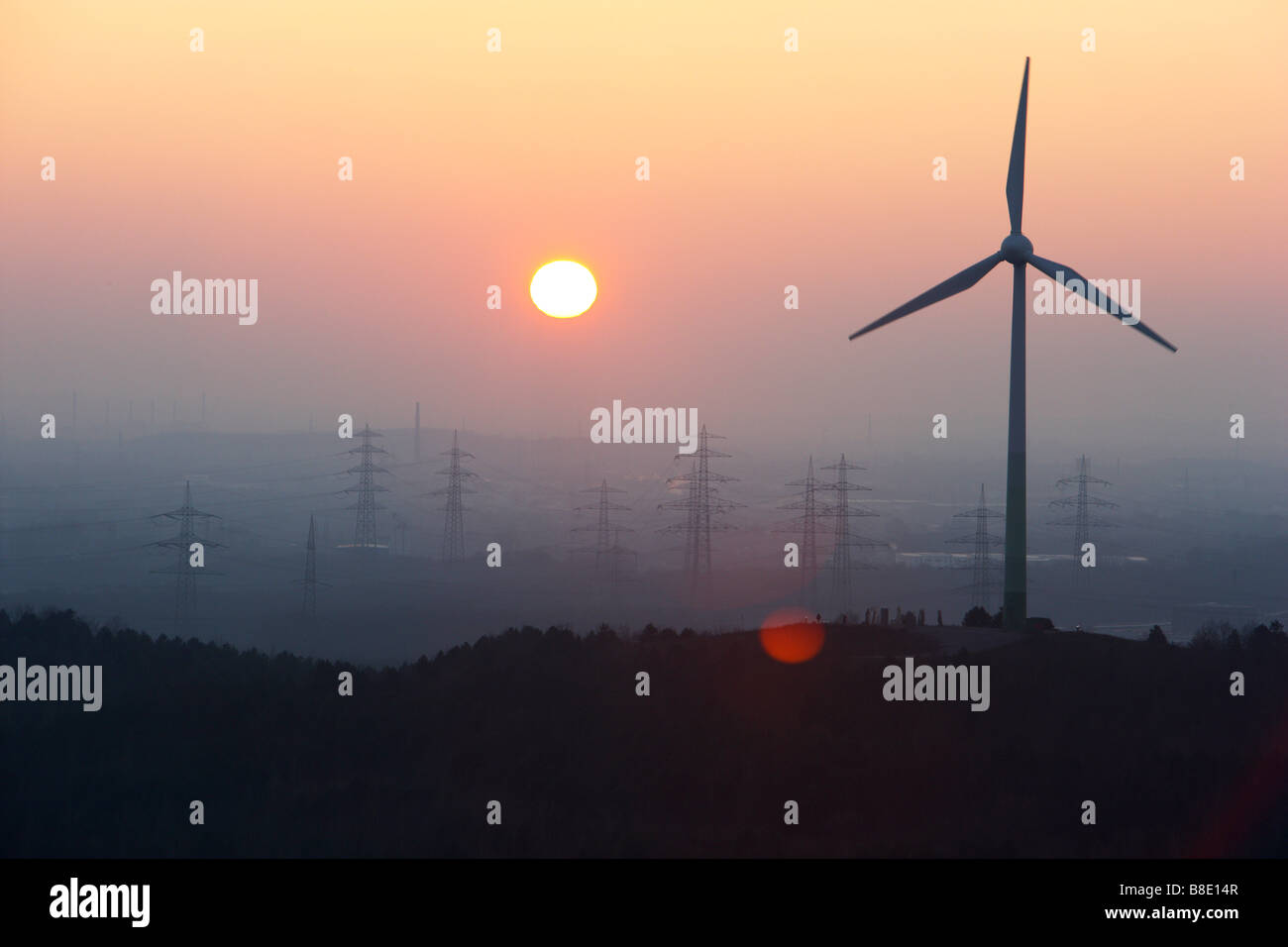 Wind power station on Hoppenbruch tip sunset Herten Germany - Stock Image
