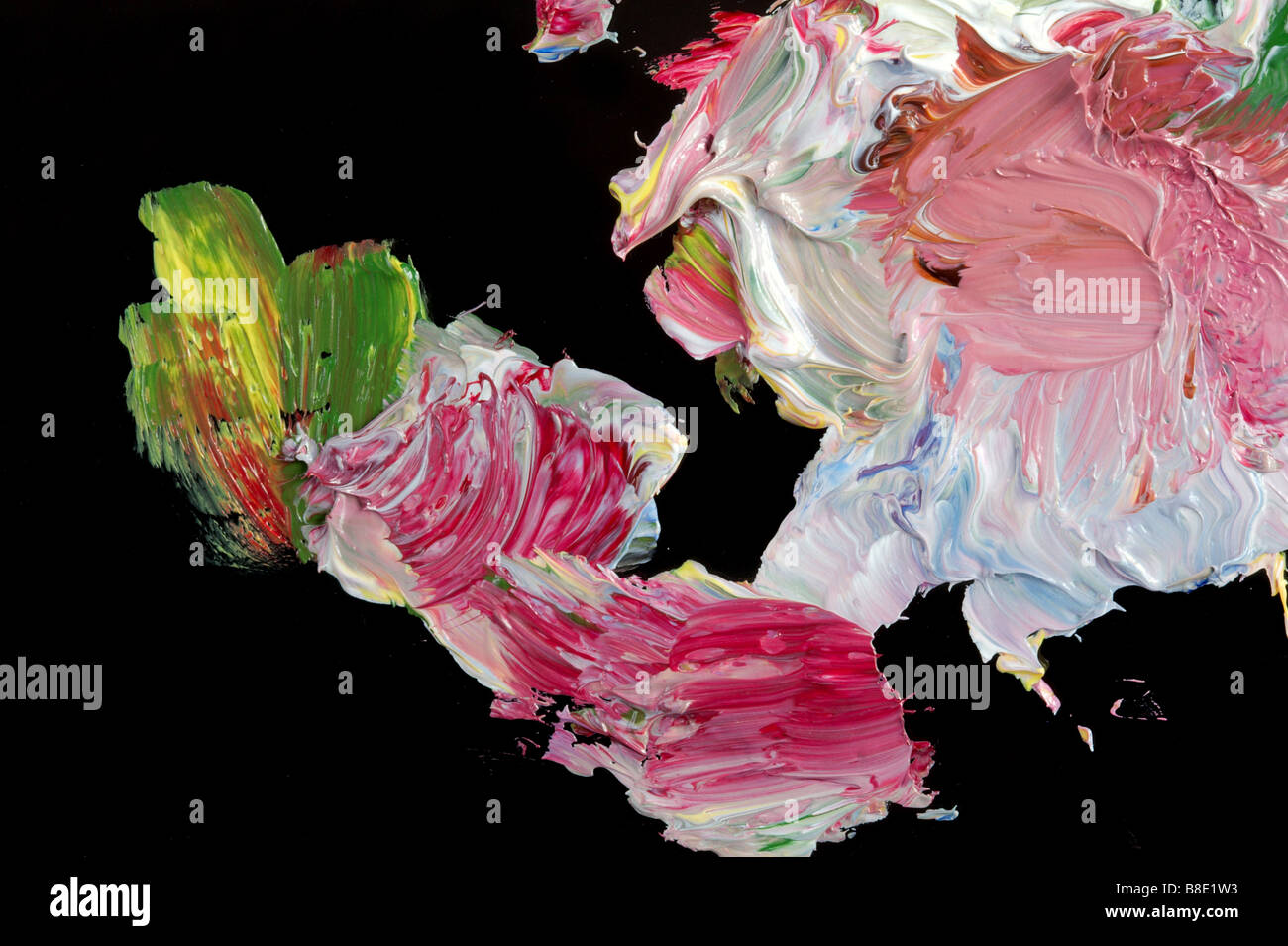 Mixing of an oil paint on black glass - Stock Image
