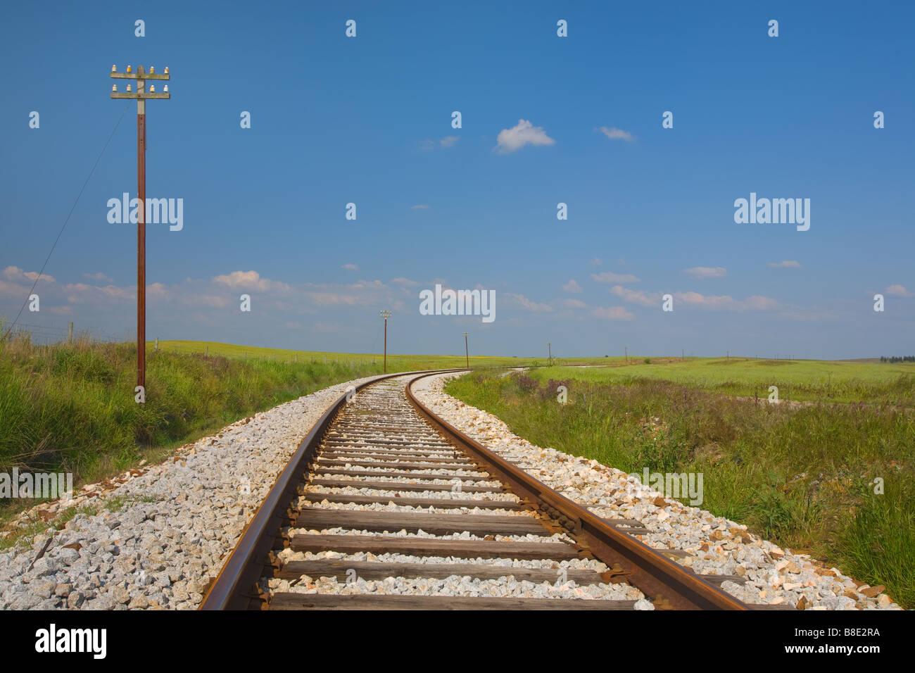 Train line wih blue sky at Castro Verde, Alentejo, Portugal - Stock Image