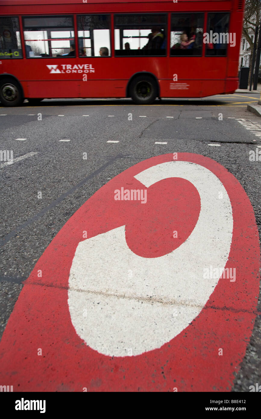 Congestion charging for London zone sign, and a red double deck bus, on the A4 road in West London. - Stock Image