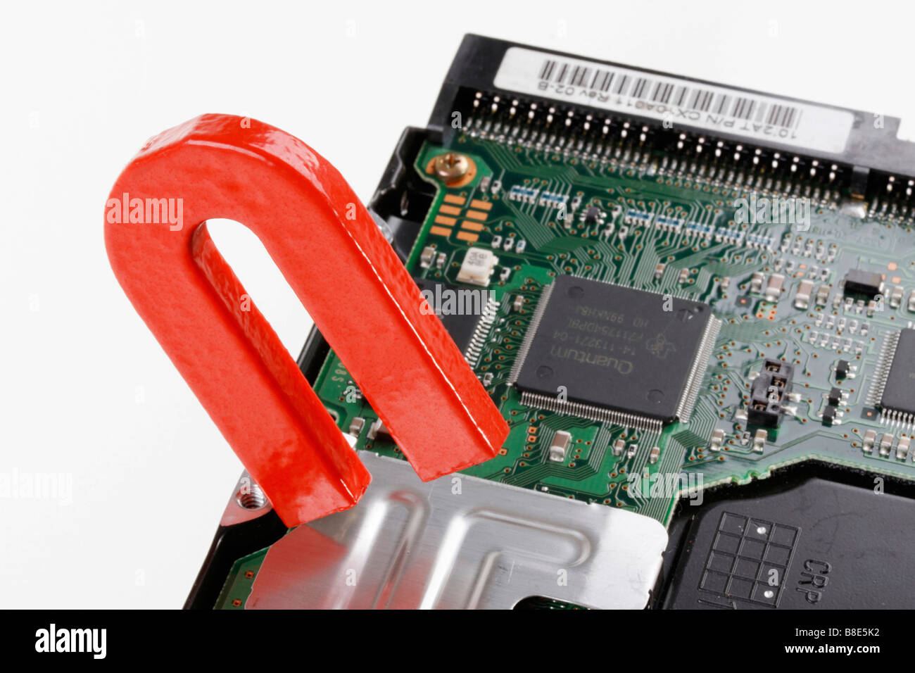 data destruction on computer hard disk by magnet - Stock Image