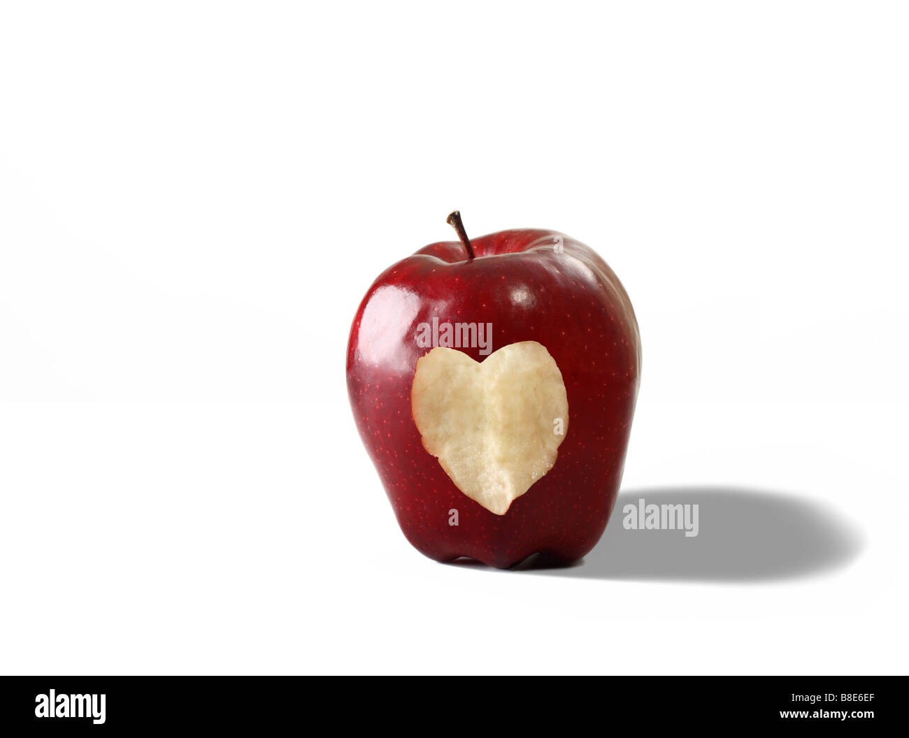 Fresh Organic Apple With Cut Out Heart Shape Stock Photo