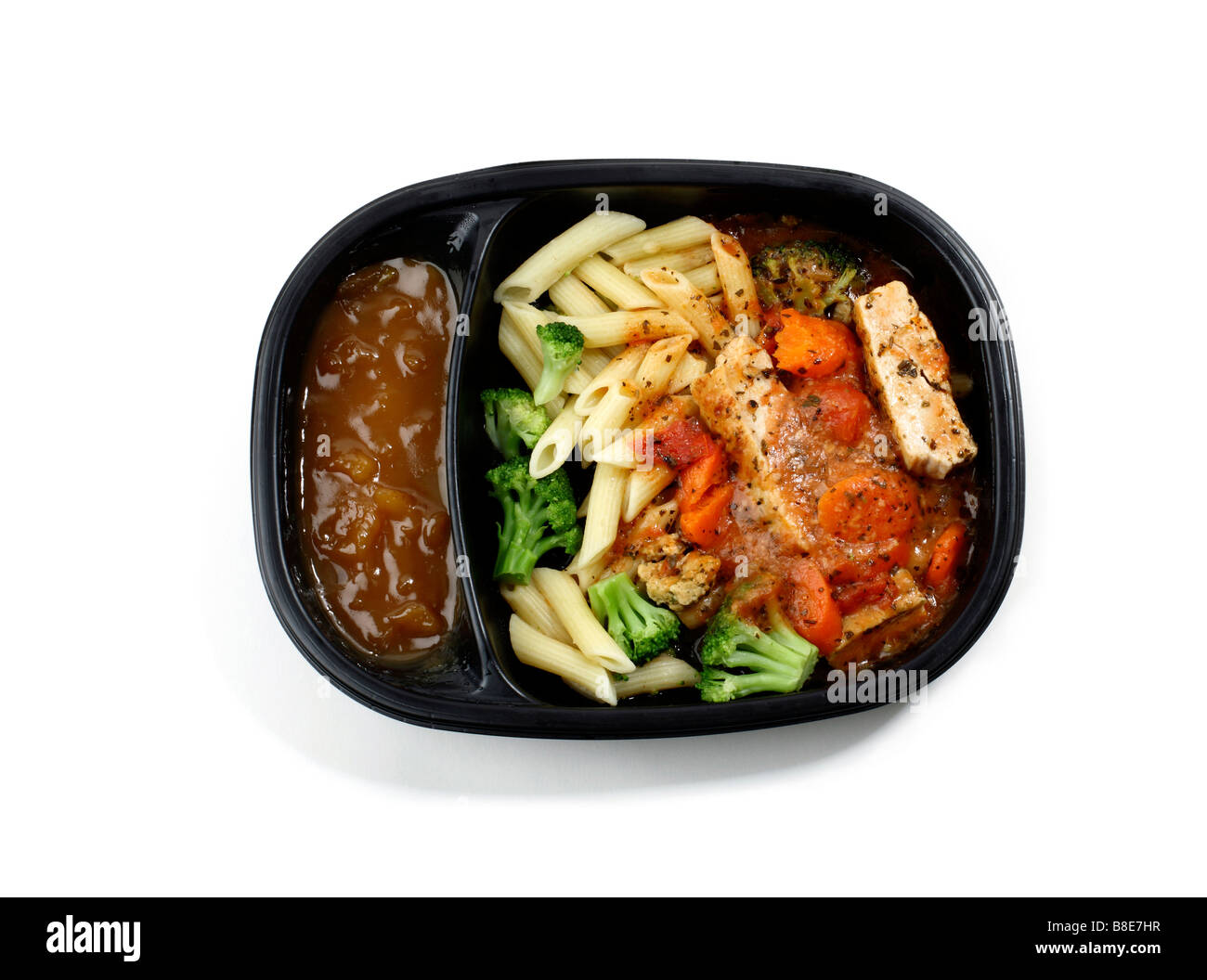 Cooked frozen chicken and pasta Dinner - Stock Image
