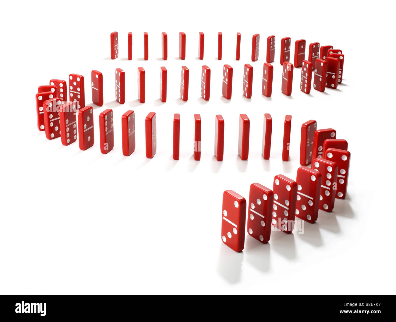 Studio shot of a row of red Domino's lined up - Stock Image