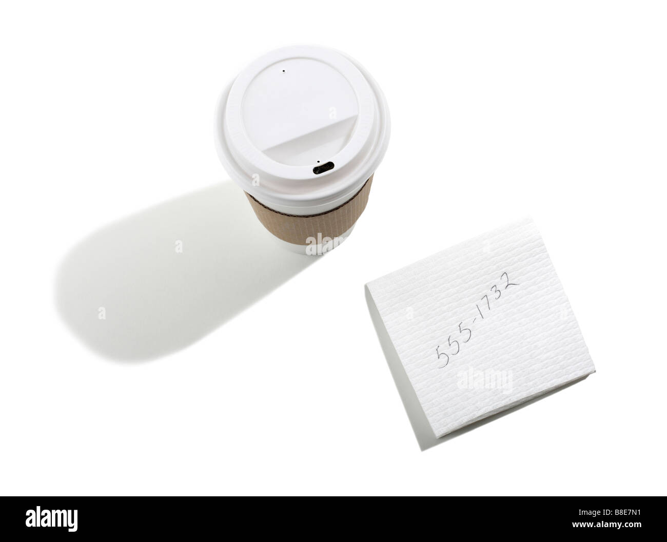 Take out Coffee Cup and Telephone number on Napkin - Stock Image