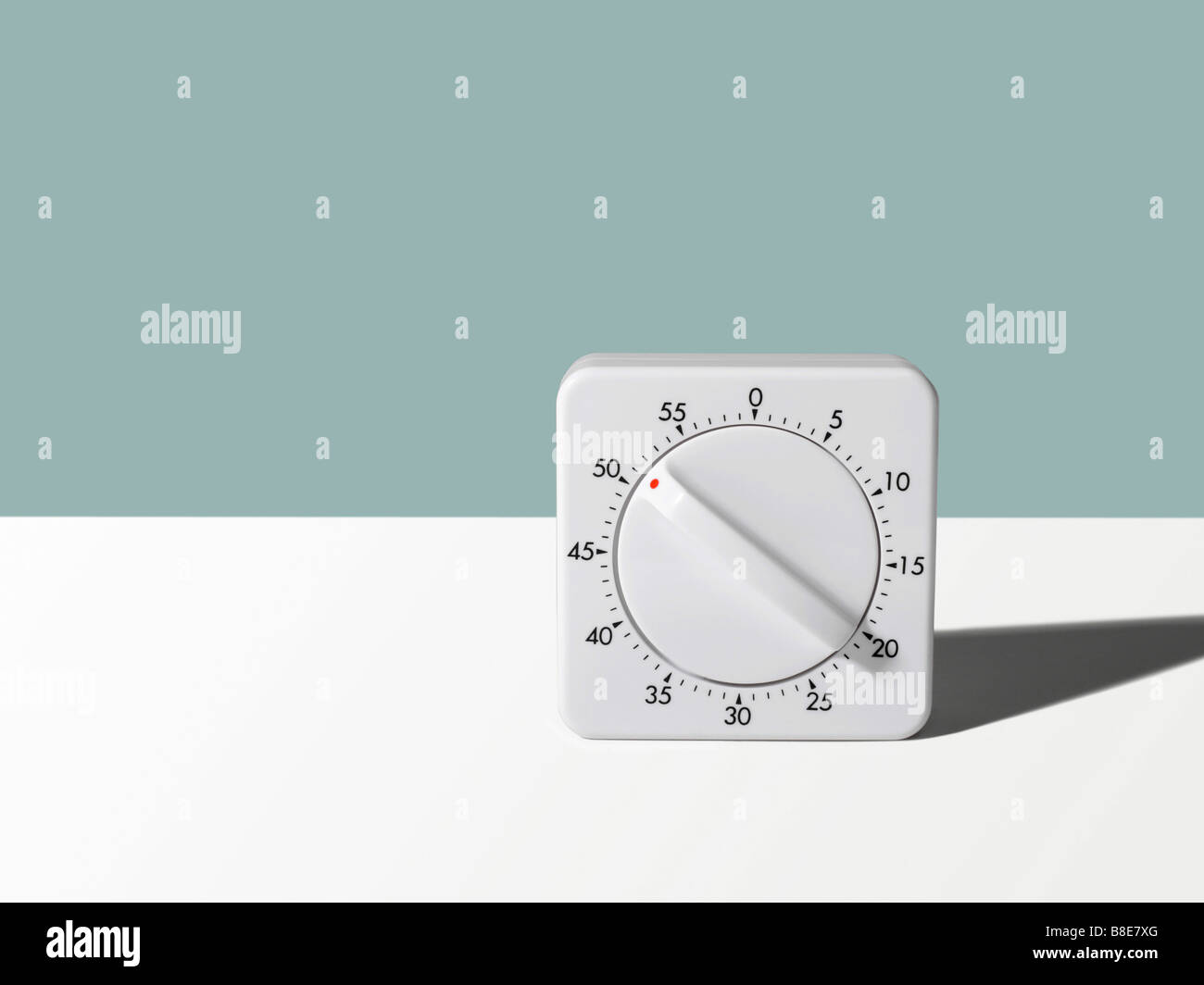 Studio shot of a wind up Kitchen Timer - Stock Image