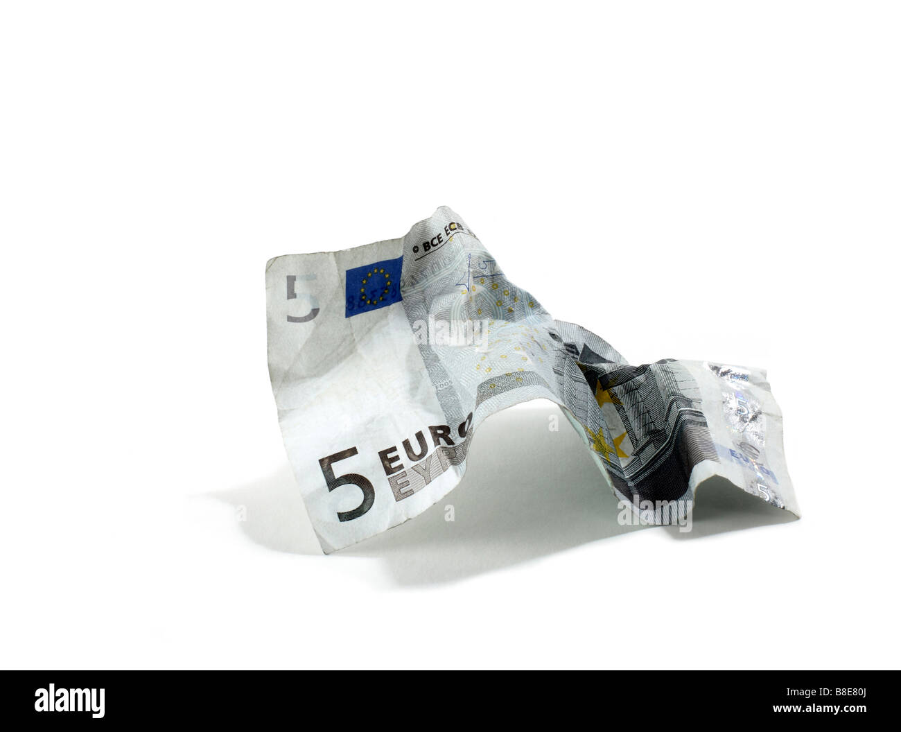 Crumpled Five Euro Note - Stock Image