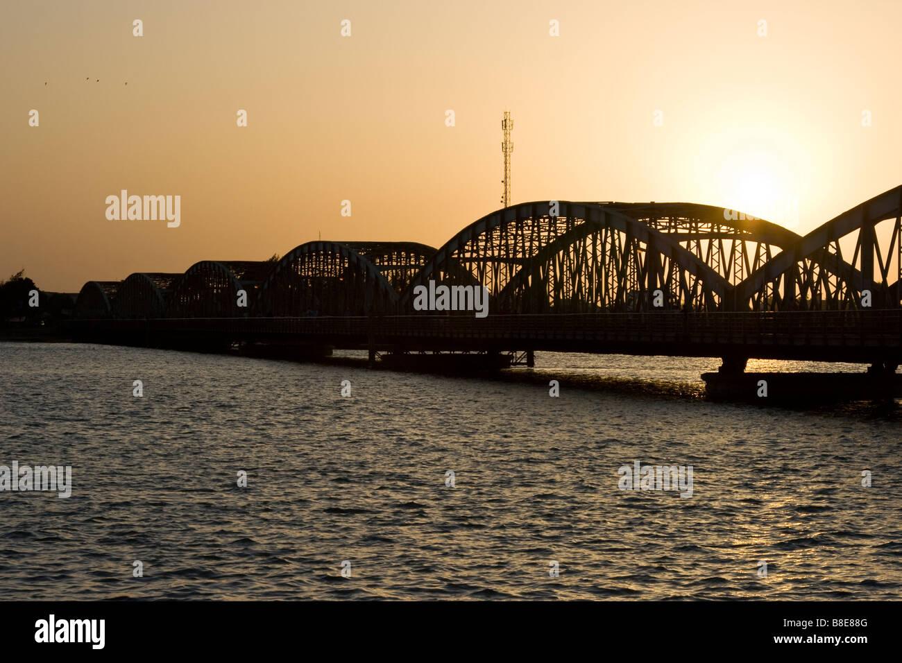 Sunrise on the Faidherbe Bridge in St Louis in Senegal Africa - Stock Image