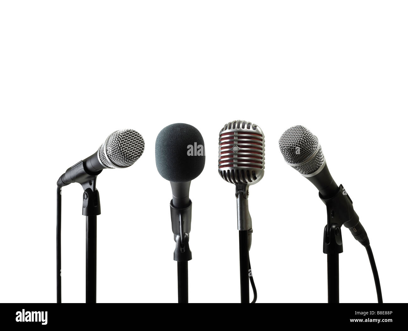 Four Microphones on Stand - Stock Image